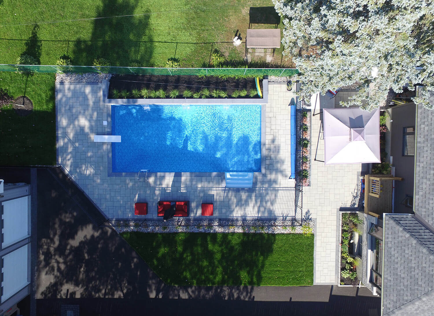 aerial view of backyard oasis with new inground pool and landscaping