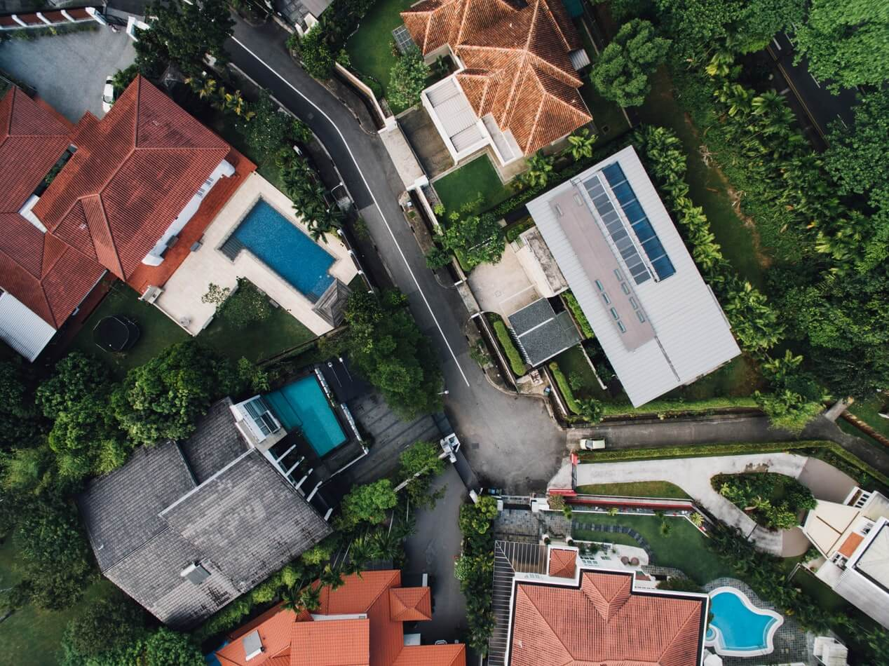 A bird's eye view of the variety of inground pools available in several backyards.