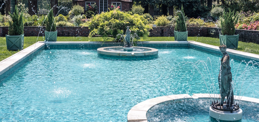 Pool with fountain water features