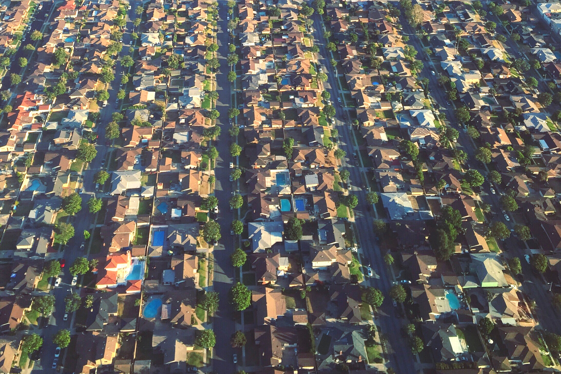 Aerial view of neighbourhood with lots of swimming pools