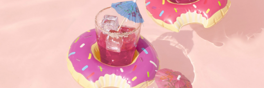 three mini donut drink floaters hold beverages in the pool